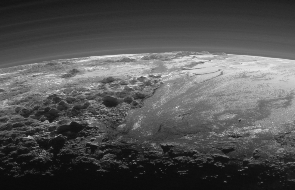 A close up showing the jagged peaks of Pluto's Norgay Montes, some of which reach 3,500m. The late evening sunlight captures just how rugged this terrain is.