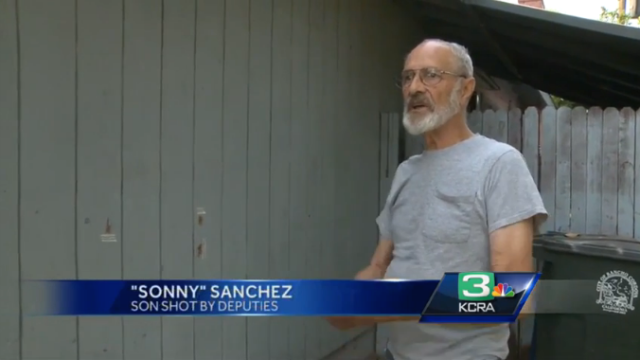 """John """"Sonny"""" Sanchez's son was shot by police. Bullet holes are visible on his garage."""