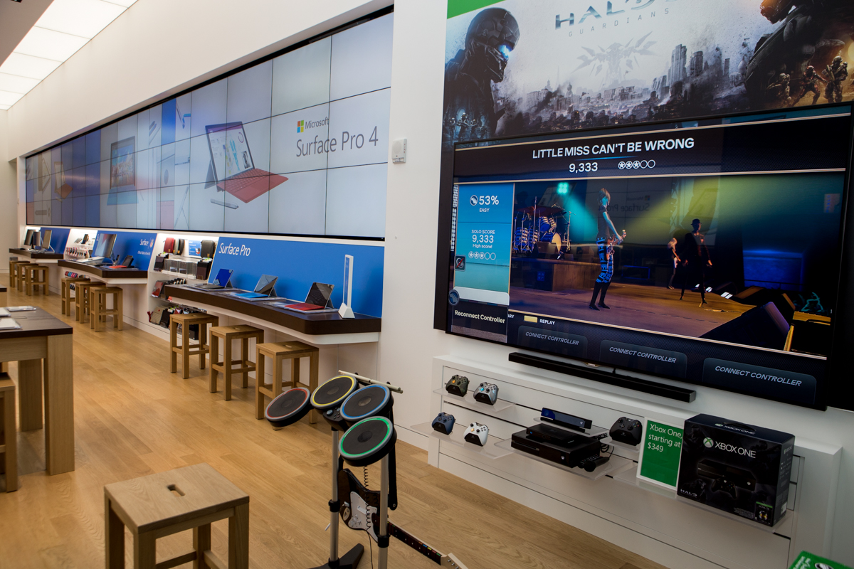 An Xbox One setup with a huge TV.