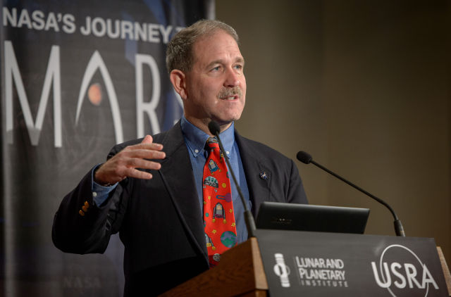 John Grunsfeld, associate administrator of NASA's science programs, speaks during the Mars Landing Site/Exploration Zone Workshop.