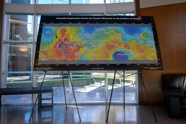 A poster showing proposed exploration zones is seen during the Mars Landing Site/Exploration Zone Workshop in Houston.
