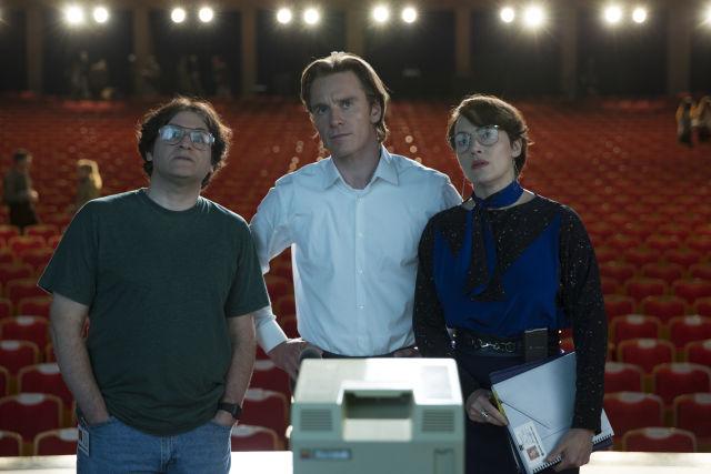 Left to right: Michael Stuhlbarg as Andy Hertzfeld, Michael Fassbender as Steve Jobs, and Kate Winslet as Joanna Hoffman in <em>Steve Jobs</em>.