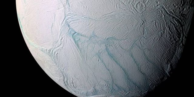 "This Cassini spacecraft view of Enceladus shows the moon's active south pole and its ""tiger stripes."""
