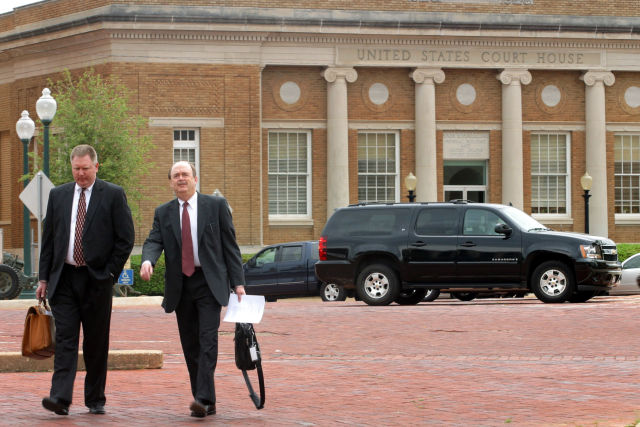 Two unidentified men leave the federal courthouse in Marshall, Texas, in 2008. (Photo by Mario Villafuerte/Bloomberg via Getty Images)