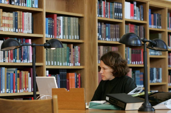 A woman studies at the Cecil H. Green Library on the Stanford University Campus in 2004. Libraries at Harvard, Stanford, the University of Michigan, the New York Public Library, and the University of Oxford were the first to participate in Google's books digitization project.