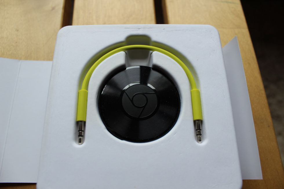 Chromecast Audio! Identical size to the standard 2015 Chromecast. Those vinyl-like grooves are purely intentional. (This one also requires power via a USB mini cable.)