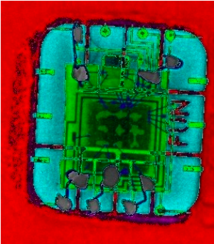 """False colour X-ray image of the forgery. Different colours correspond to different materials. The stolen chip is clearly visible in green,"" the researchers write."