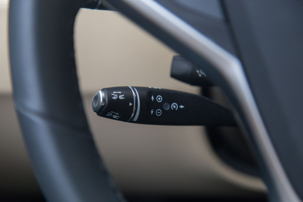 Symbols on the assistive driving stick. Pull forward drive for Autopilot, move up for down for cruise control speed adjust, and twist for car following.