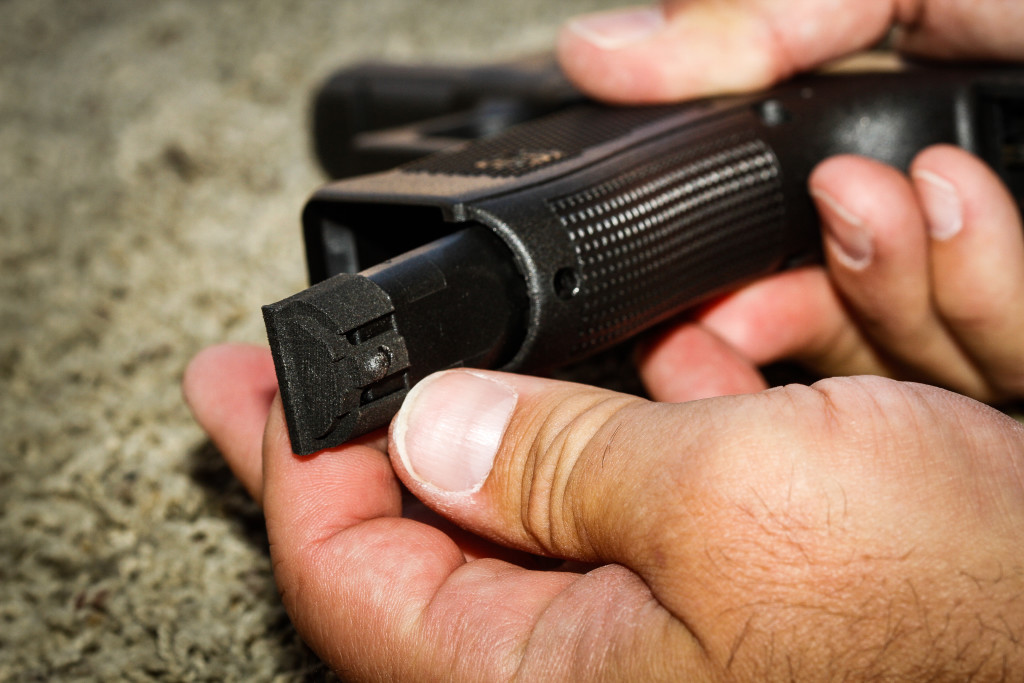 Jim Schaff of Yardarm shows off the sensor in place on a Glock 22 at a shooting range in San Jose, California, on Thursday, September 10, 2015. The sensor can alert dispatchers when an officer pulls his or her weapon and when shots have been fired and transmit the location back to dispatch.