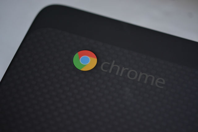 The Chrome logo on the lid of the Chromebook 13.