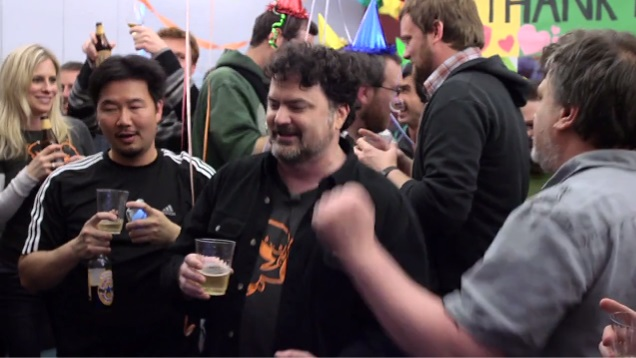 The double Fine team celebrates the successful funding of their Kickstarter.