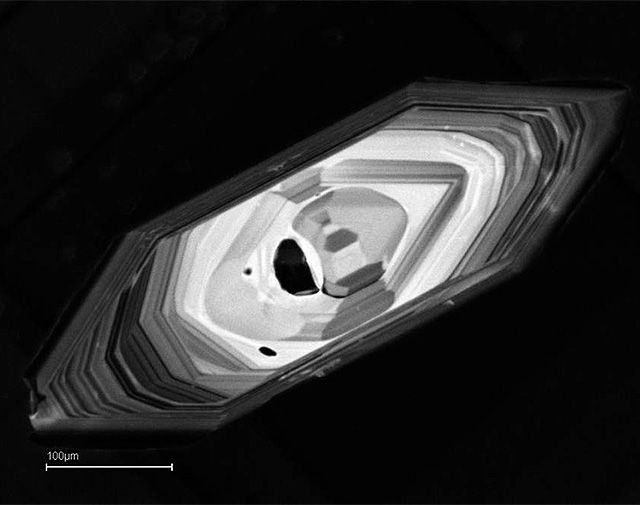 The scale bar on this image of a zircon crystal is roughly the width of a human hair.