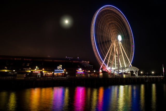 Drone collides with Seattle Ferris wheel, busts through plastic table