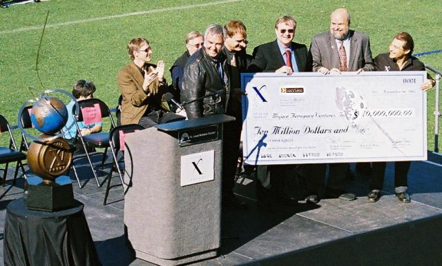 Paul Allen (third from right) and Burt Rutan (fifth from right) receive the Ansari X PRIZE in 2004.