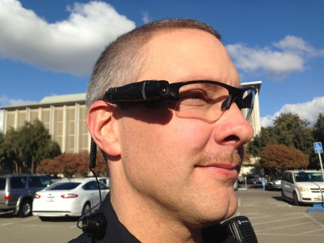 An officer with the Fresno Police Department wears a Taser Axon Flex body-worn camera.