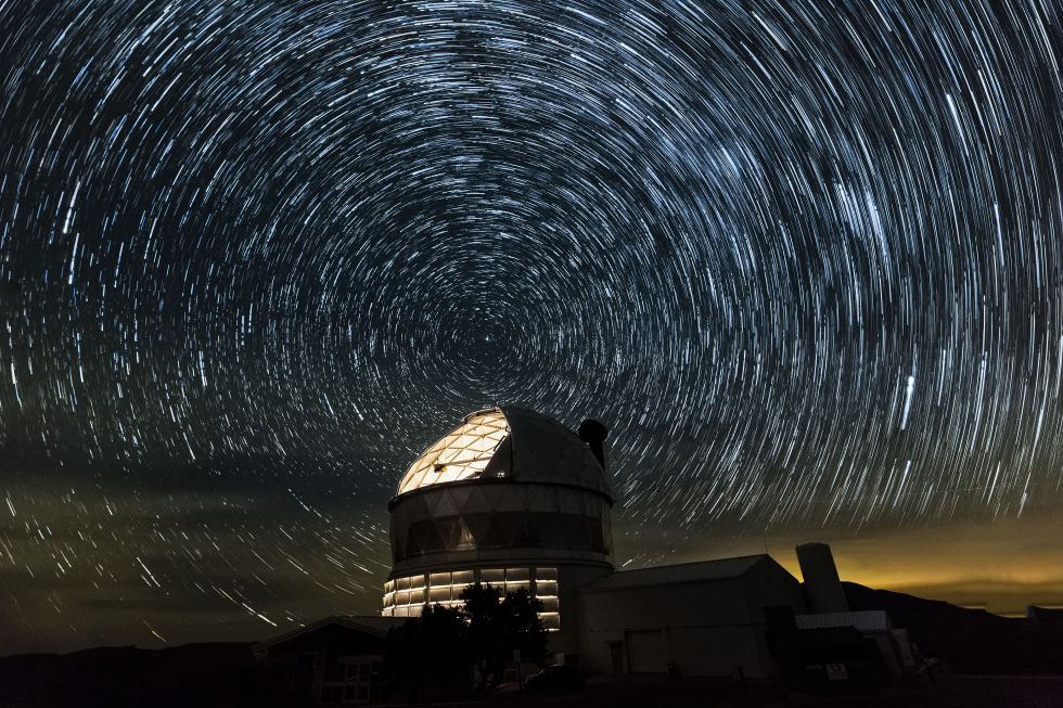 Star trails swirl around Polaris, above the Hobby-Eberly Telescope.