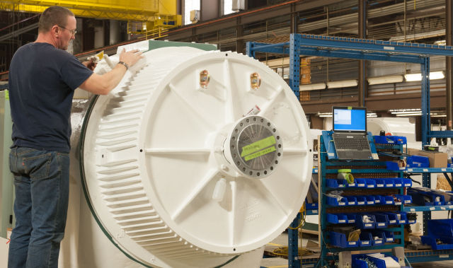 An older version of Northern's 100 kilowatt turbine runs through some tests at the end of the assembly line.