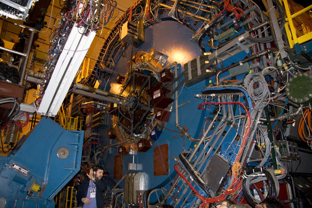 Brookhaven's STAR detector, with a standard-sized physicist included for scale.