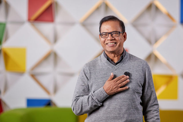 Google SVP Amit Singhal wearing the prototype device.