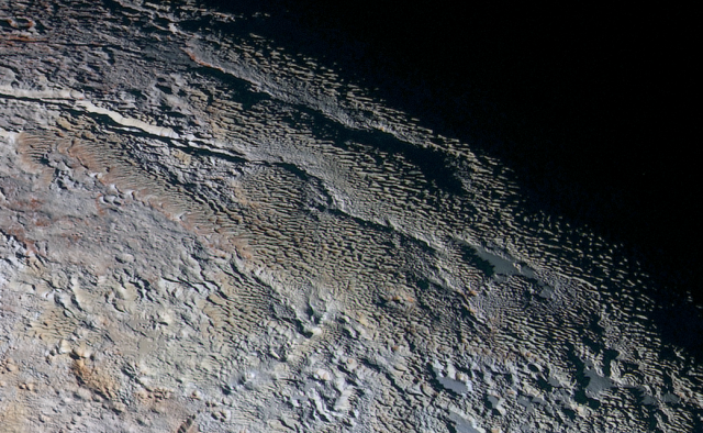 Why, for goodness' sake, do some parts of Pluto look like snake skin?