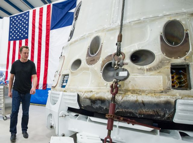 Elon Musk views the historic Dragon capsule that returned to Earth on May 31, 2012, after delivering cargo to the International Space Station.