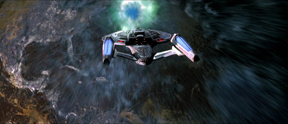 The Enterprise, caught in the wake of a temporal vortex, witnesses the Earth, assimilated long ago, in the altered timeline.
