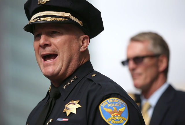 "San Francisco Police Chief Greg Suhr (L) at a news conference last year. ""Anyone capable of the reprehensive texts that these guys sent should not be police officers, and we will work for that to be the case,"" Suhr said on Monday. (Photo by Justin Sullivan/Getty Images)"