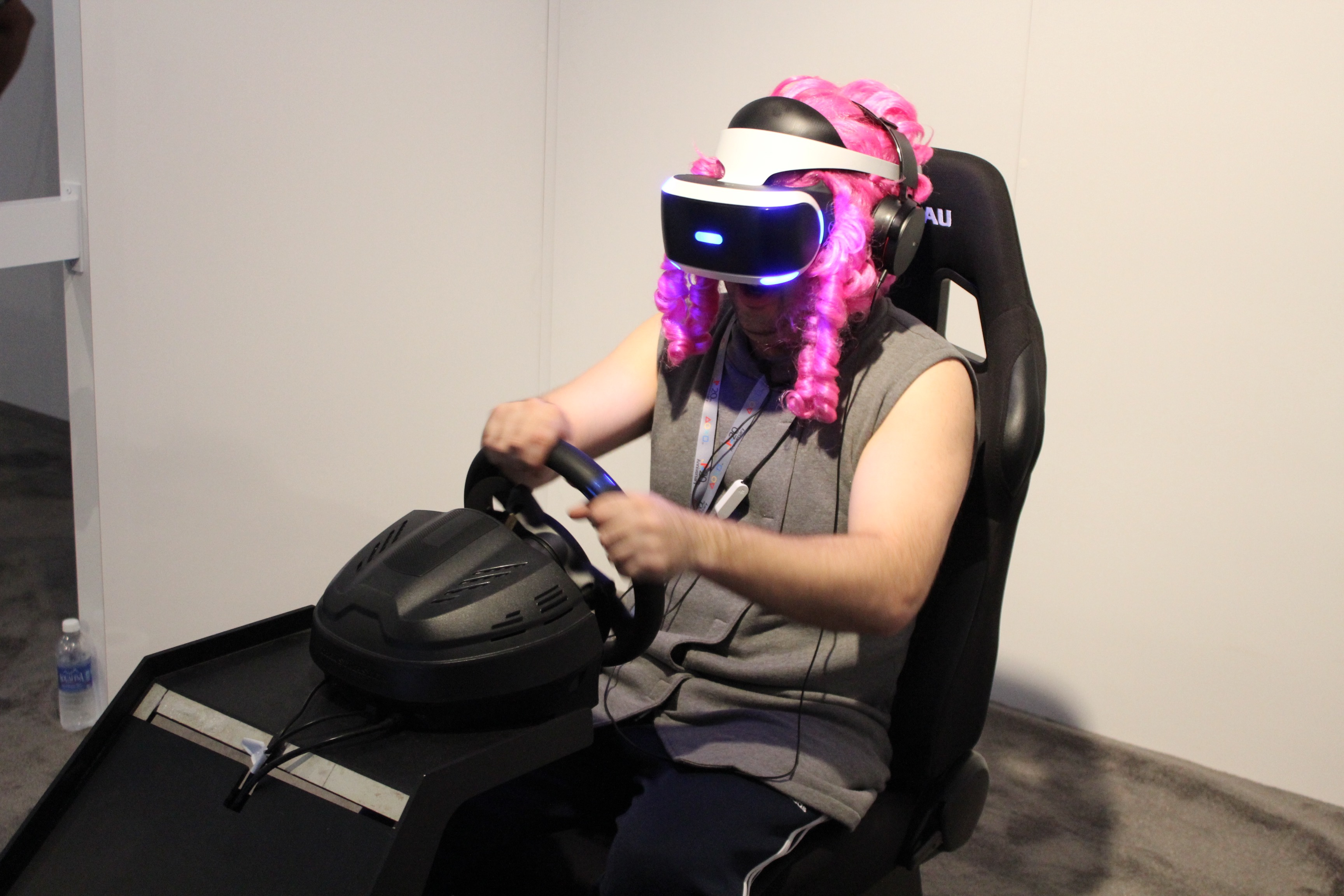The <em>Driveclub VR</em> demo wasn't improved by its steering wheel and driving seat combo. Might've been better with that guy's wig, though.