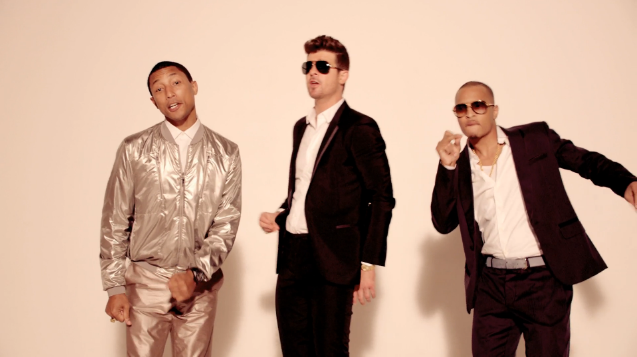 "Pharrell Williams, Robin Thicke, and T.I. in the video for ""Blurred Lines."""