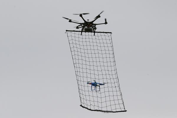 Tokyo's drone squad will deploy 10-foot drones armed with nets to police the sky