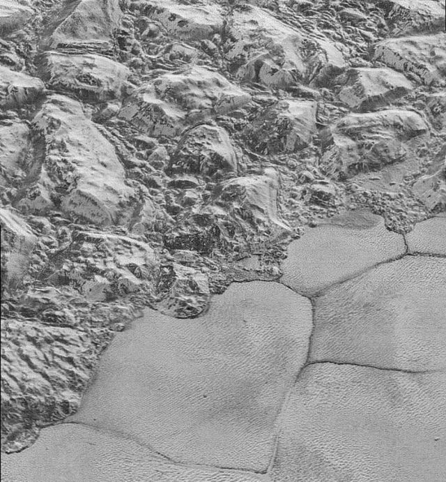 Behold: the mountainous shoreline of Sputnik Planum.