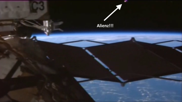 "Screen capture of YouTube video showing ""mysterious"" pink object spotted by an International Space Station camera."