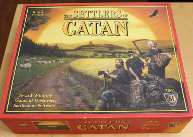 "Thanks to today's announcement, future English-language copies of <em>Settlers of Catan</em> will probably have that giant ""M"" for Mayfair removed or changed to reflect Asmodee's acquisition."
