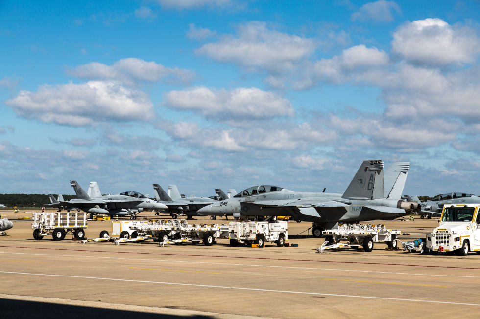 Modern F/A-18 Super Hornets once belonging to VFA-106 parked on the flight line at NAS Oceana in Virginia. The Super Hornet owes much its design impetus to the threat posed by the MiG-21.