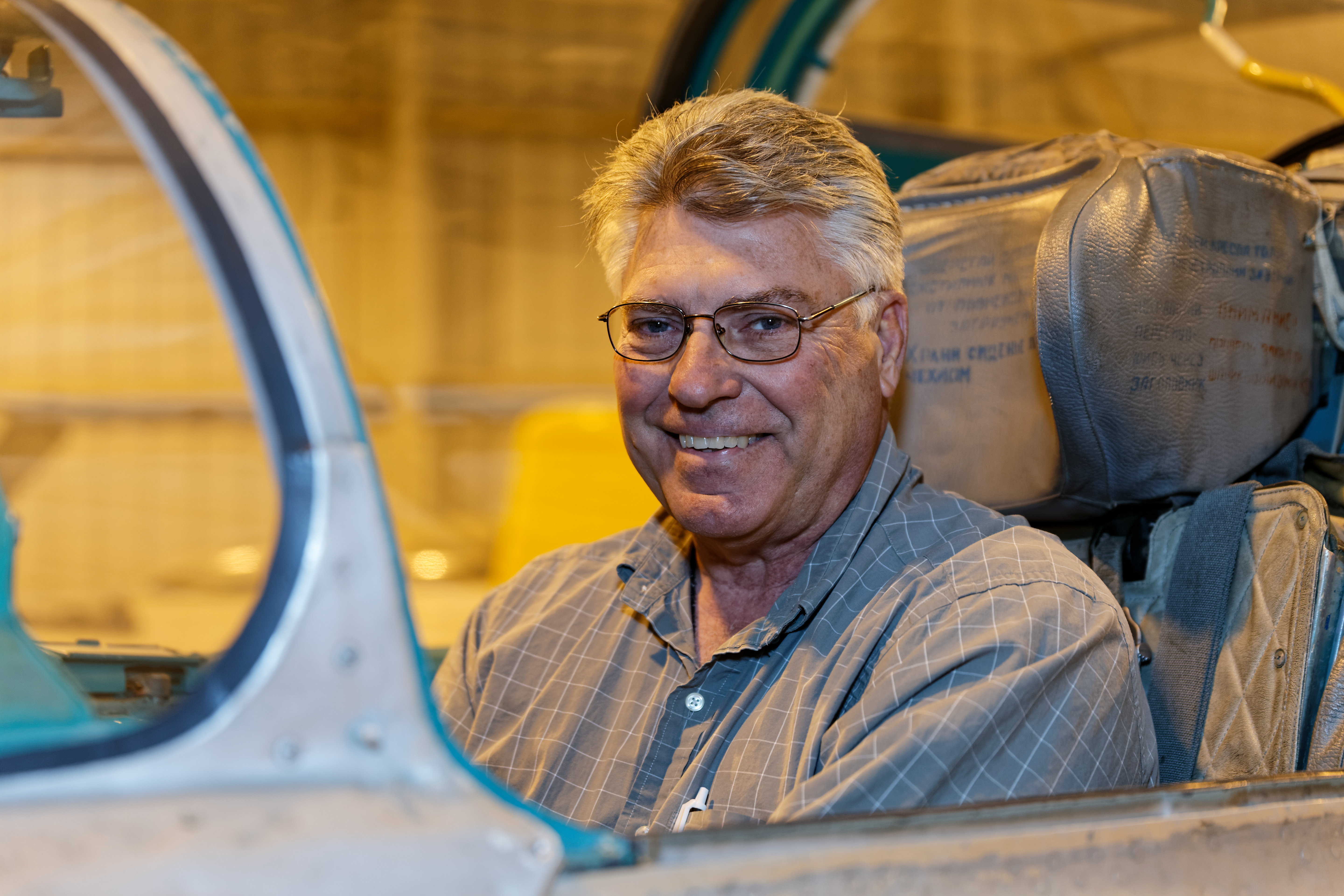 Pilot Rick Sharpe, smiling from the cockpit of his MiG-21.