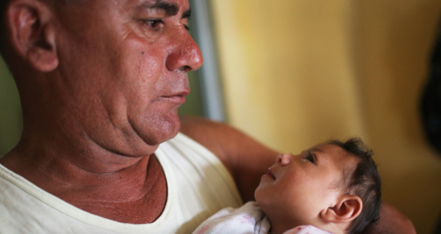 Alice Vitoria Gomes Bezerra, a three-month-old who has microcephaly, is held by her father Joao Batista Bezerra on January 27, 2016 in Recife, Brazil. (Mario Tama for Getty Images)