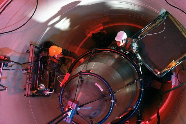 Don't drop a wrench, man: airmen perform maintenance on a Minuteman III missile.