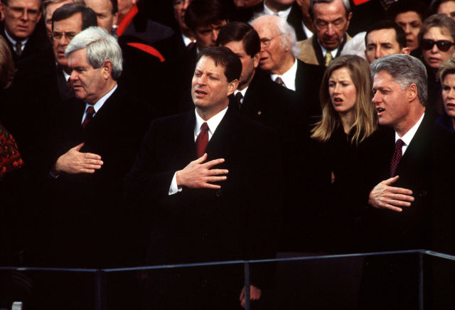Newt Gingrich, Al Gore, and Bill Clinton sing the National Anthem at the 1997 Presidential Inaugural Swearing-in Ceremony. Under their watch the gravitational wave detectors got built.