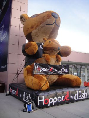 "Dish shows off its two ""marsupial-inspired products,"" the Hopper DVR and the companion box Joey, at CES in 2013."