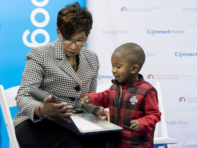 A Kansas City resident and her son, two of the first people to get free gigabit Internet from Google Fiber.