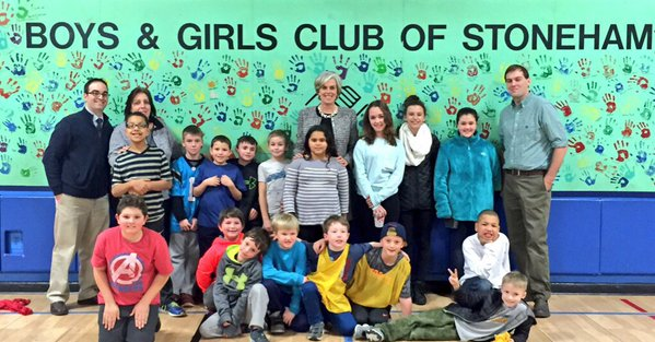 Rep. Katherine Clark (D-Mass.), top-center, poses with a Boys and Girls Club two weeks before being targeted in an apparent swatting attack.