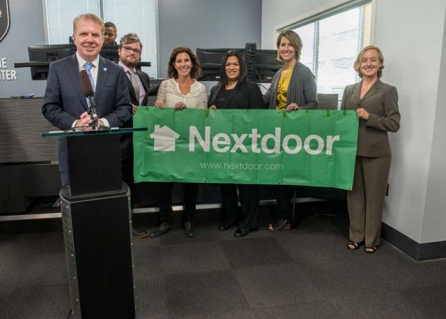 Seattle Mayor Ed Murray (left) and police chief Kathleen O'Toole (third from left) stand with Seattle city neighborhood leaders at an October 2015 press conference.