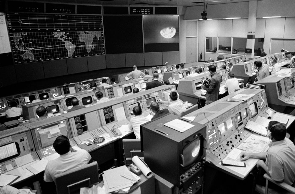 Mission Control, on the third day of Apollo 8. Seen on the TV monitor is a picture of Earth telecast from the spacecraft 176,000 miles away.