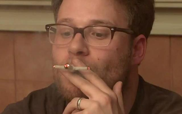 Seth Rogen demonstrates his Kylo Ren lightsaber joint.