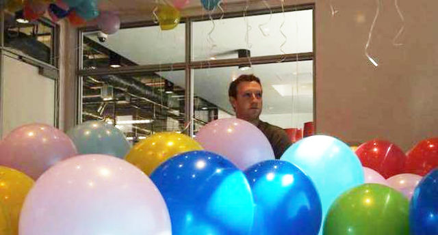 A not-fazed Mark Zuckerberg seen here having a party with some balloons.