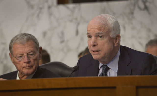 Sen. McCain asks questions at a  Senate Armed Services Committee in 2014.
