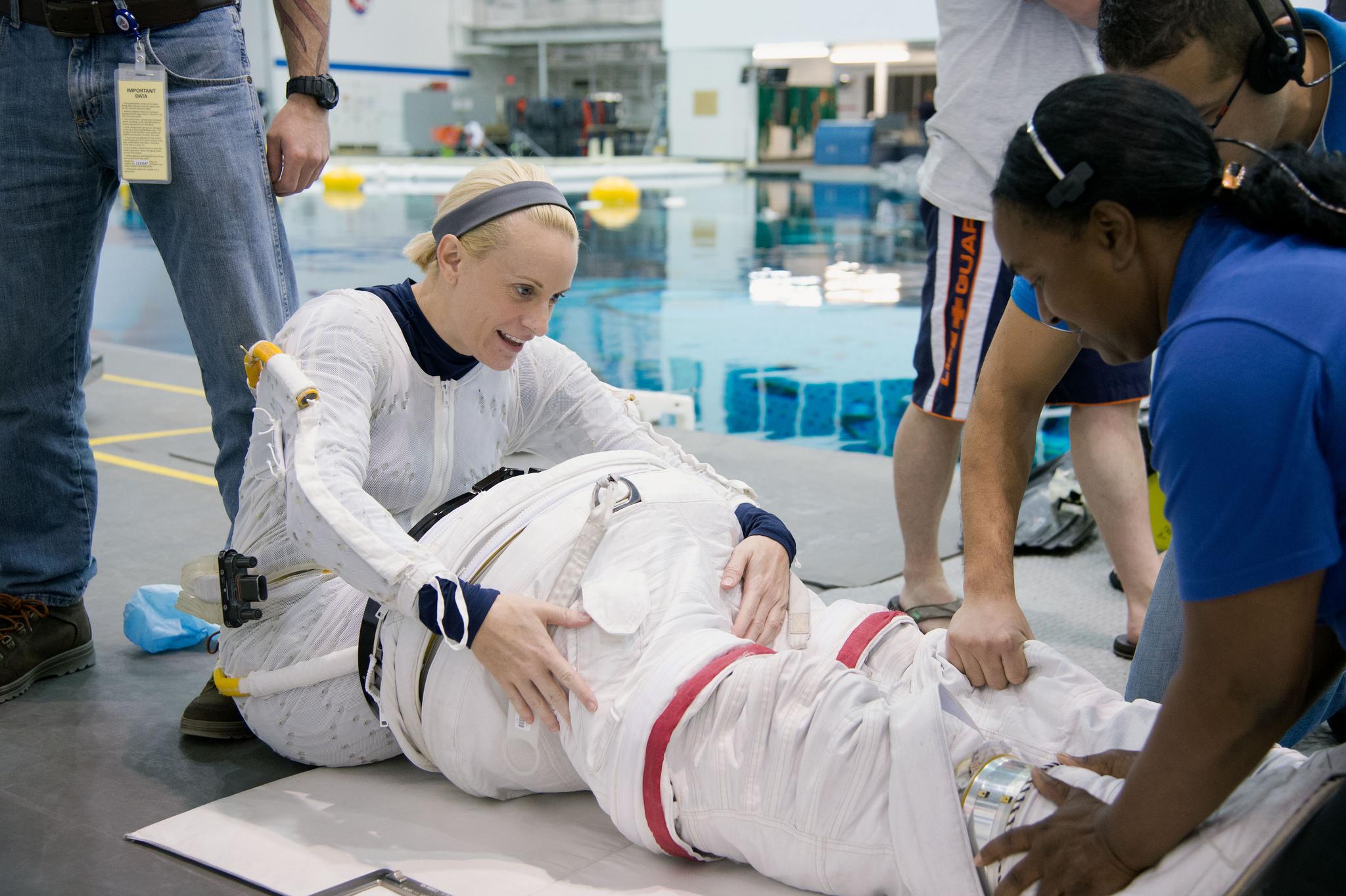 Kate Rubins undergoes spacewalk training at NASA's Neutral Buoyancy Laboratory.