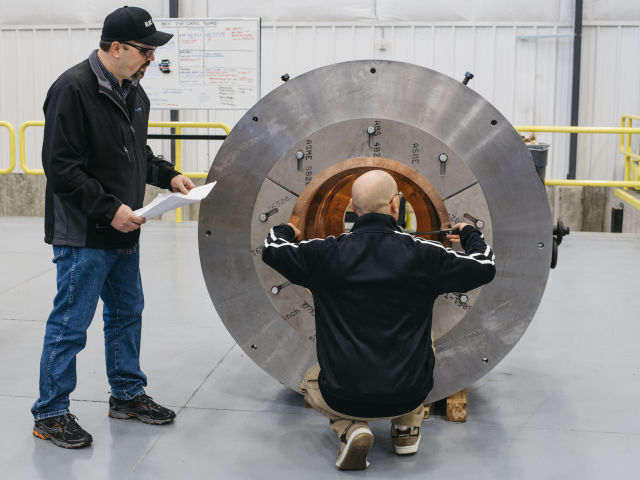 Blue Origin engineers examine BE-4 Main Combustion Chamber at Blue Origin's rocket factory near Seattle in 2016.