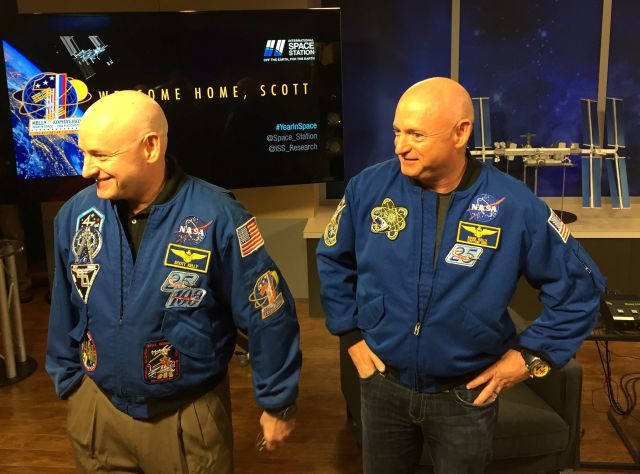 Scott Kelly, left, and his brother Mark Kelly share a laugh at the Johnson Space Center on Friday.