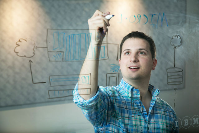 An IBM software engineer sketches out a pending patent. IBM has acquired more US patents than any other company for more than 20 years in a row. (Jared Lazarus/Feature Photo Service for IBM)